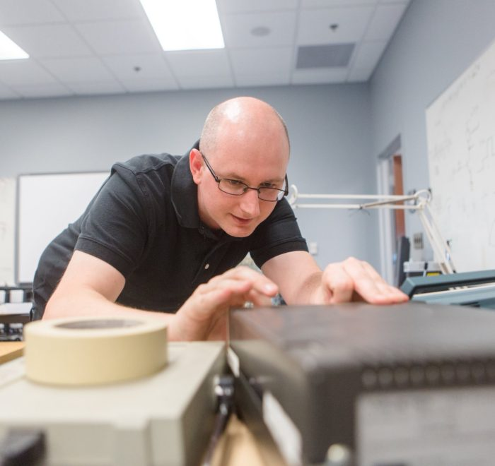 engineer technician working with electronic equipment in the lab